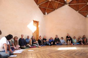 group of people sitting in a circle - Lama annual meeting
