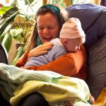woman holding an enfant