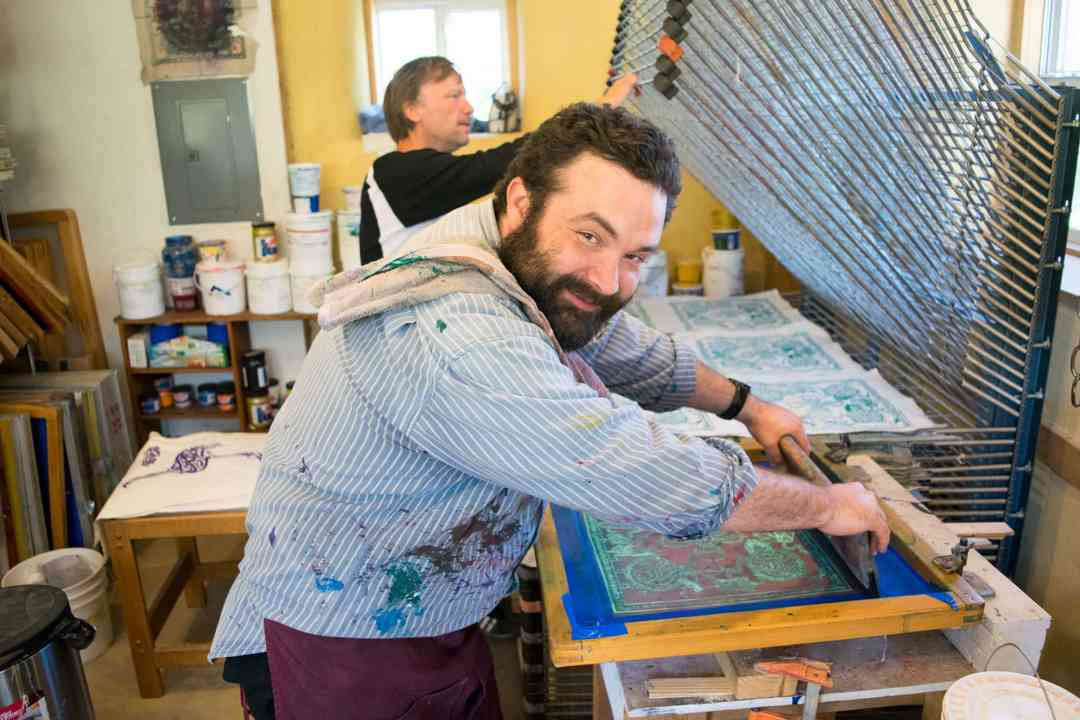 two men screen printing
